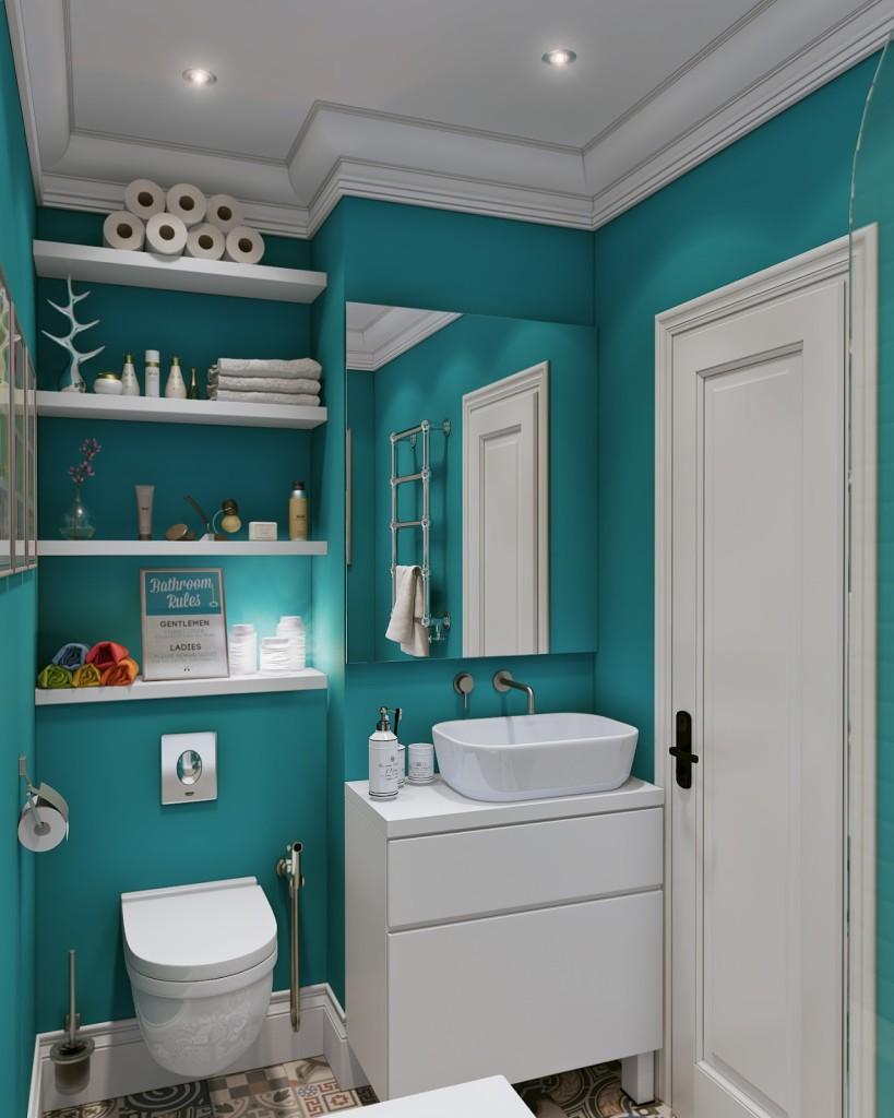 bagno con parete azzurra e mensole in nicchia