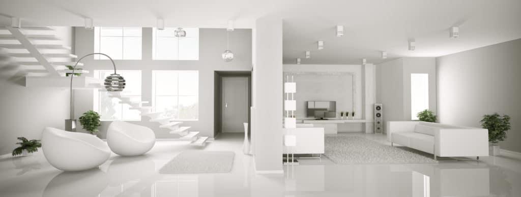 arredare una casa total white in stile minimal con poltrone scultoree e arredi dalle forme lineari