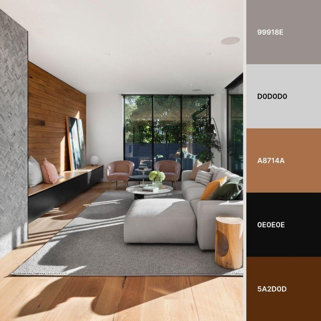soggiorno moderno con divano ad isola grigio e camino in ceramica